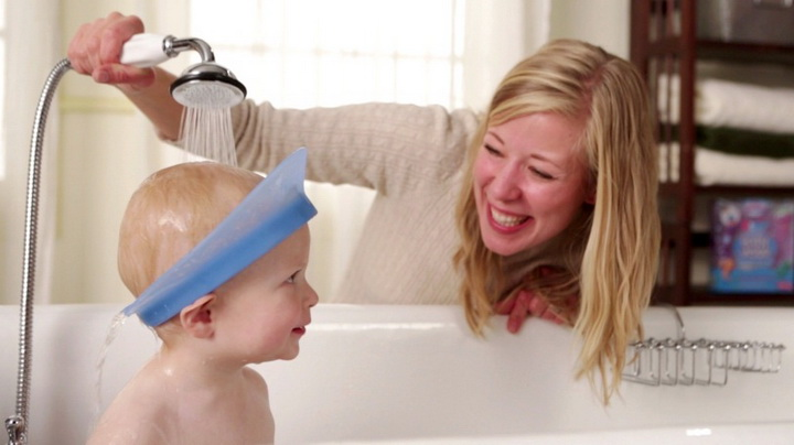 Mom washing Max's hair with Kair Bath Visor